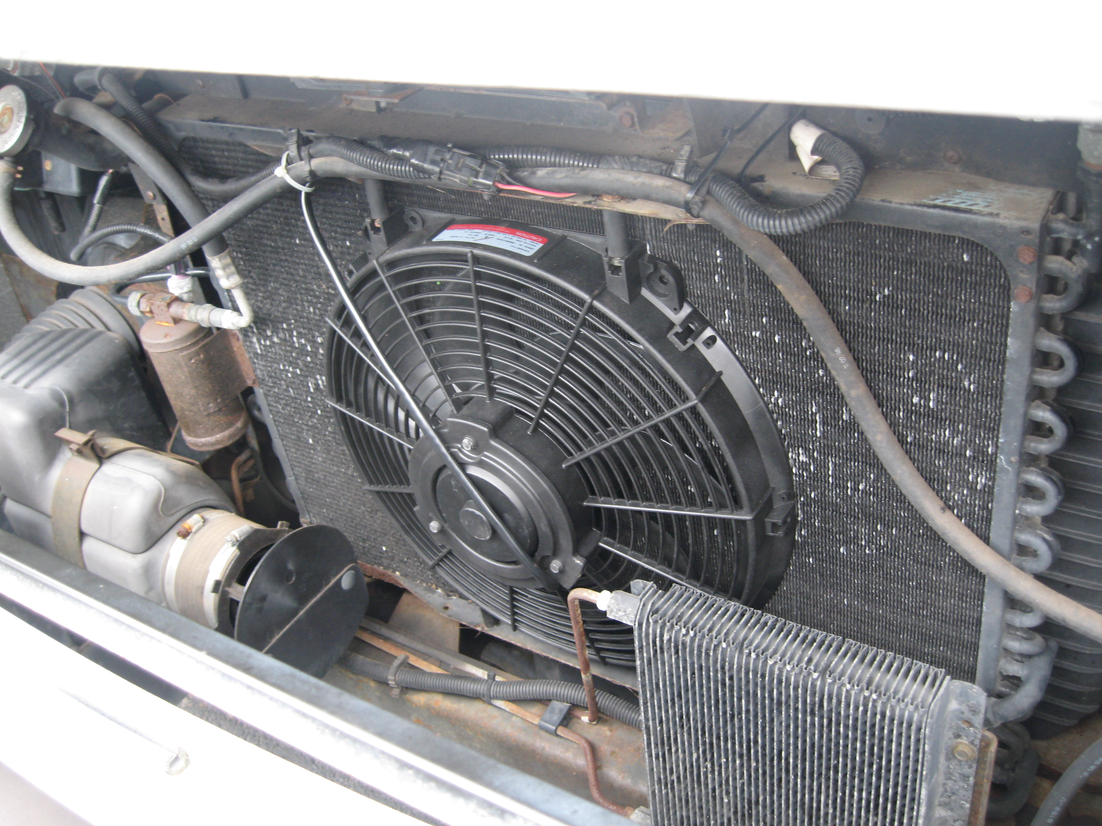 Changing The Electric Radiator Fan And Brake Fluid